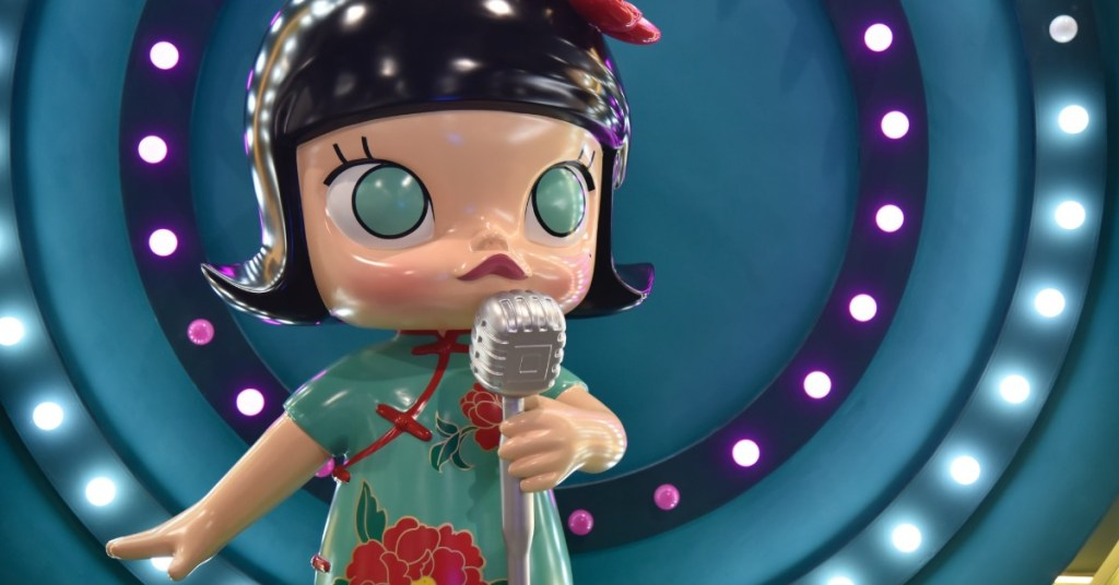 doll-singing-into-microphone