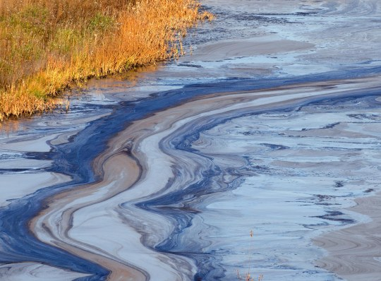 oil spill into a western river