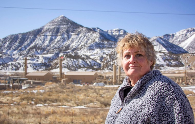 colorado resident in front of gas well