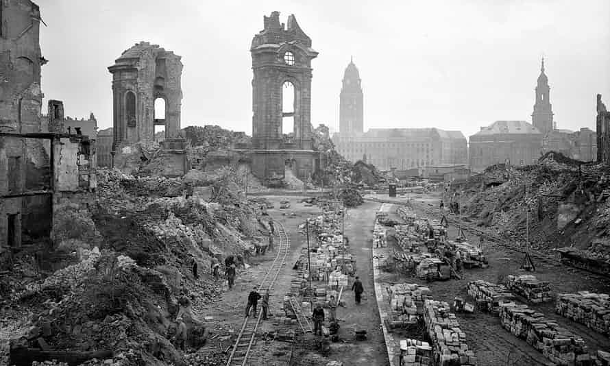 The German city of Dresden photographed in 1952, as workers remove bomb debris in front of the ruins of the Frauenkirche