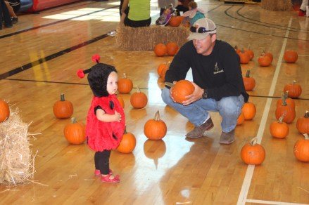 Landri & Daddy picking out a pumpkin