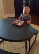 Eating like a big boy at the table