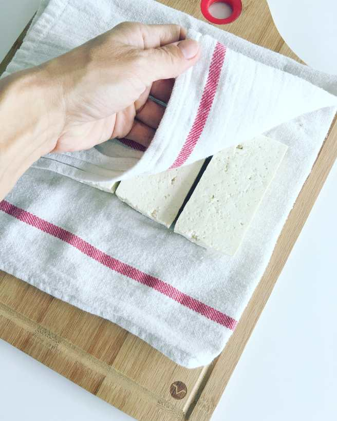 Place tofu between clean kitchen towels