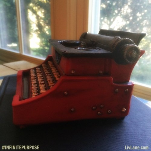 Red typewriter. (LOVE) Book announcement from Liv Lane and Lori Portka