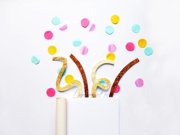 Livre et confetti pour fêter le 1000e billet du blog Livrement
