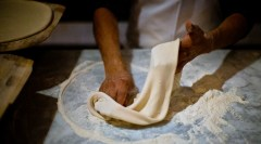 The making of pizza at a restaurant in West LA