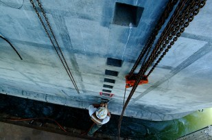A worker on the bridge project, viewed from above.