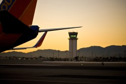 The tower at Burbank Airport, under a wing of a Southwest plane.