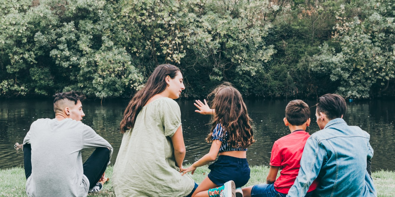 Lifestyle photographer Liyat G Haile captured children sitting by Coburg Lake Reserve in Melbourne, Victoria, Australia with nature, trees, water outdoor family photography