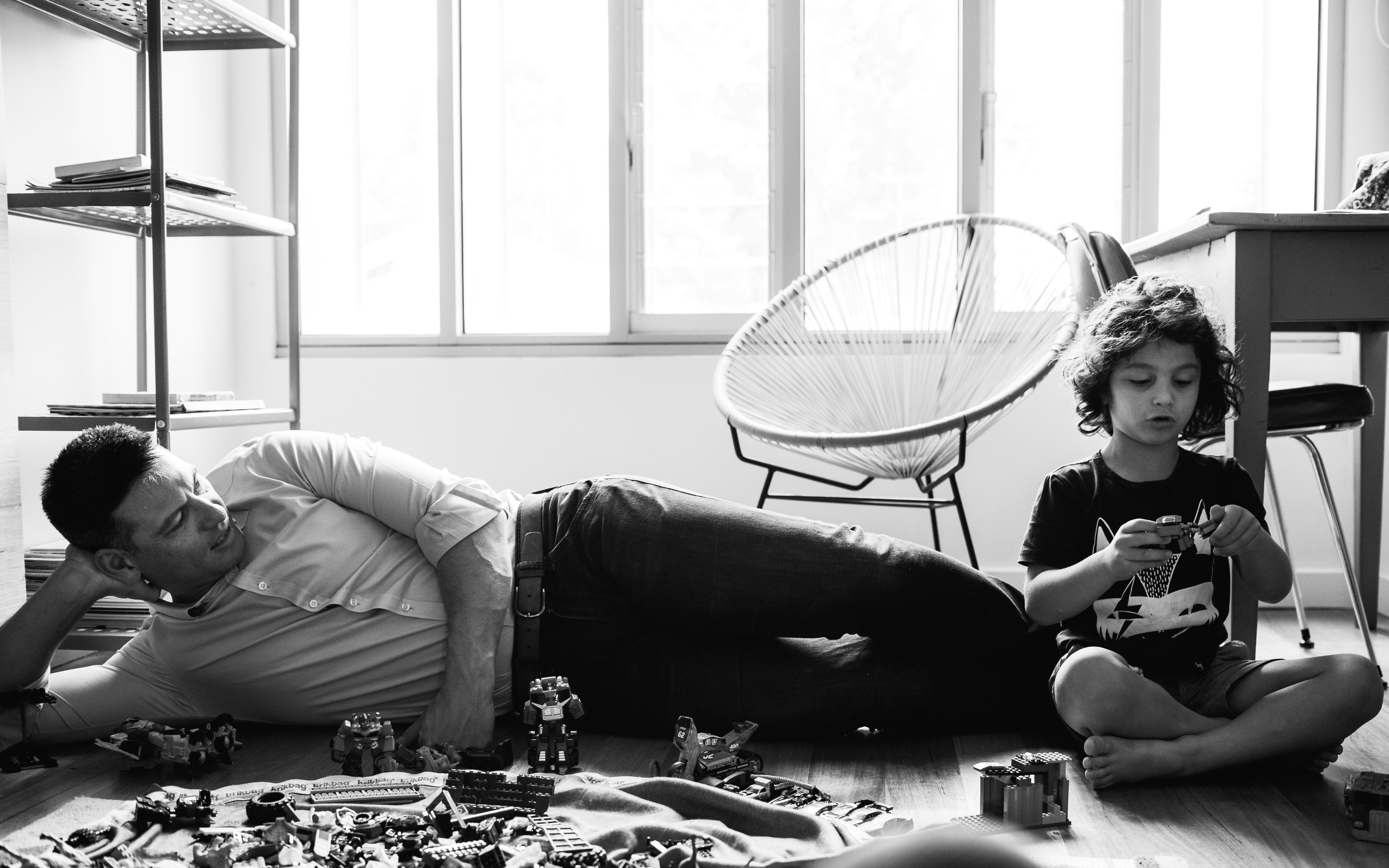 photograph of father and his boy creating and building with Lego in their bedroom in Carlton North, Melbourne, Australia