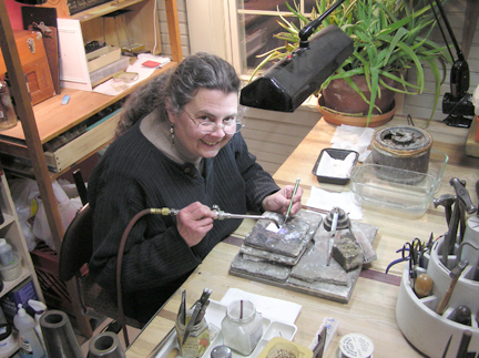 Coliene Moore is one of the artists in the building shown here in her studio.