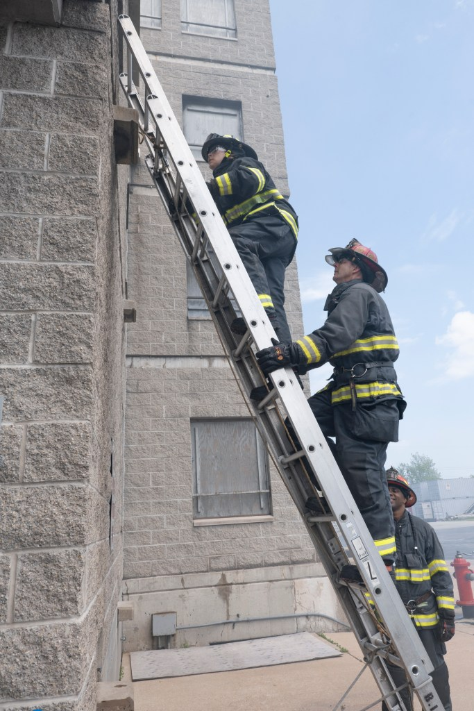 Climbing into the fire tower at MFD Firefighter for a Day. Photo credit: Dawn Haase.