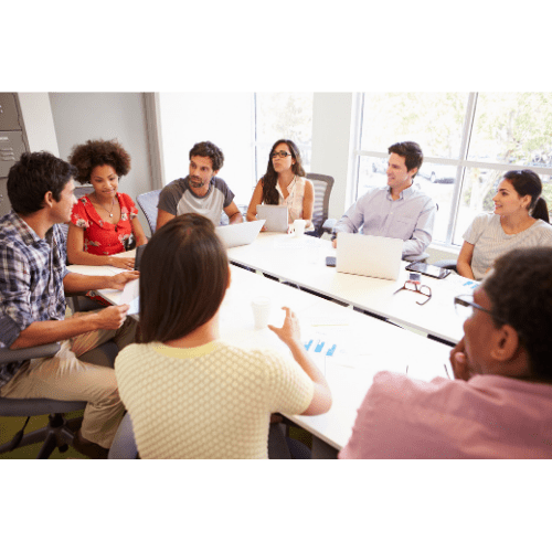 A team of professionals in a conference room with a white table