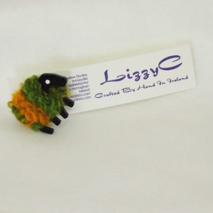 green_and_gold sheep pin on-card