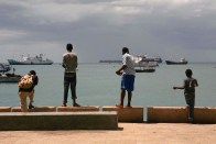 Local boys fish off of a pier in Stone Town, Zanzibar, October 22, 2011.