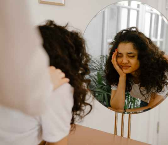 reflection of sad woman in mirror