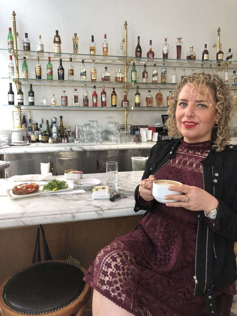 Walkable Guide to Instaworthy Spots in DTLA by Liz in Los Angeles, Los Angeles Lifestyle Blogger, image of a woman at a trendy cafe in LA