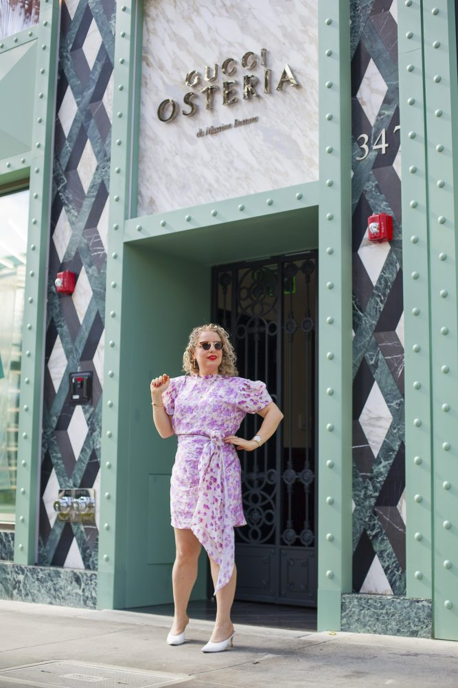 Top 10 Things to Do in LA in March, a blog post by Liz in Los Angeles, Los Angeles Lifestyle Blogger: an image of a blond women standing infront of the Gucci restaurant on Rodeo Drive