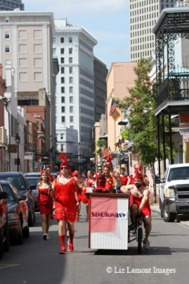 Marching through the streets on Red Dress Run day in the French Quarter.