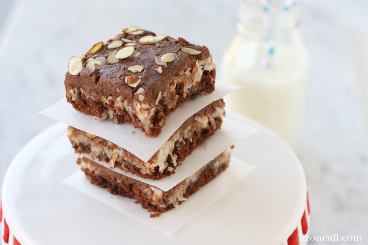 The classic flavors of almond Joy candy bars and texas sheet cake together in one rich delicious crowd pleasing dessert. Make this almond joy sheet cake for your next party.