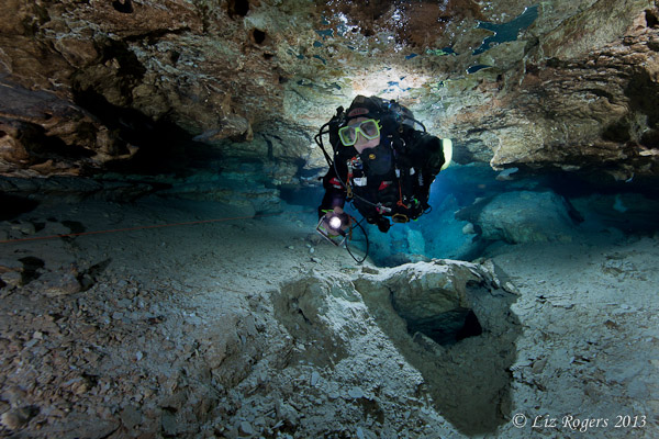 Glowing cave diver