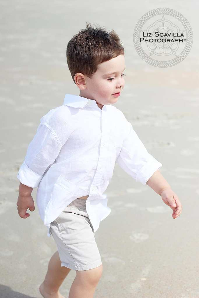 Boy Walking Along the Beach