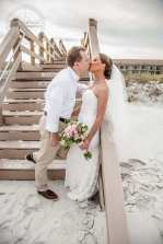 Bride and Groom on Beach Stairs