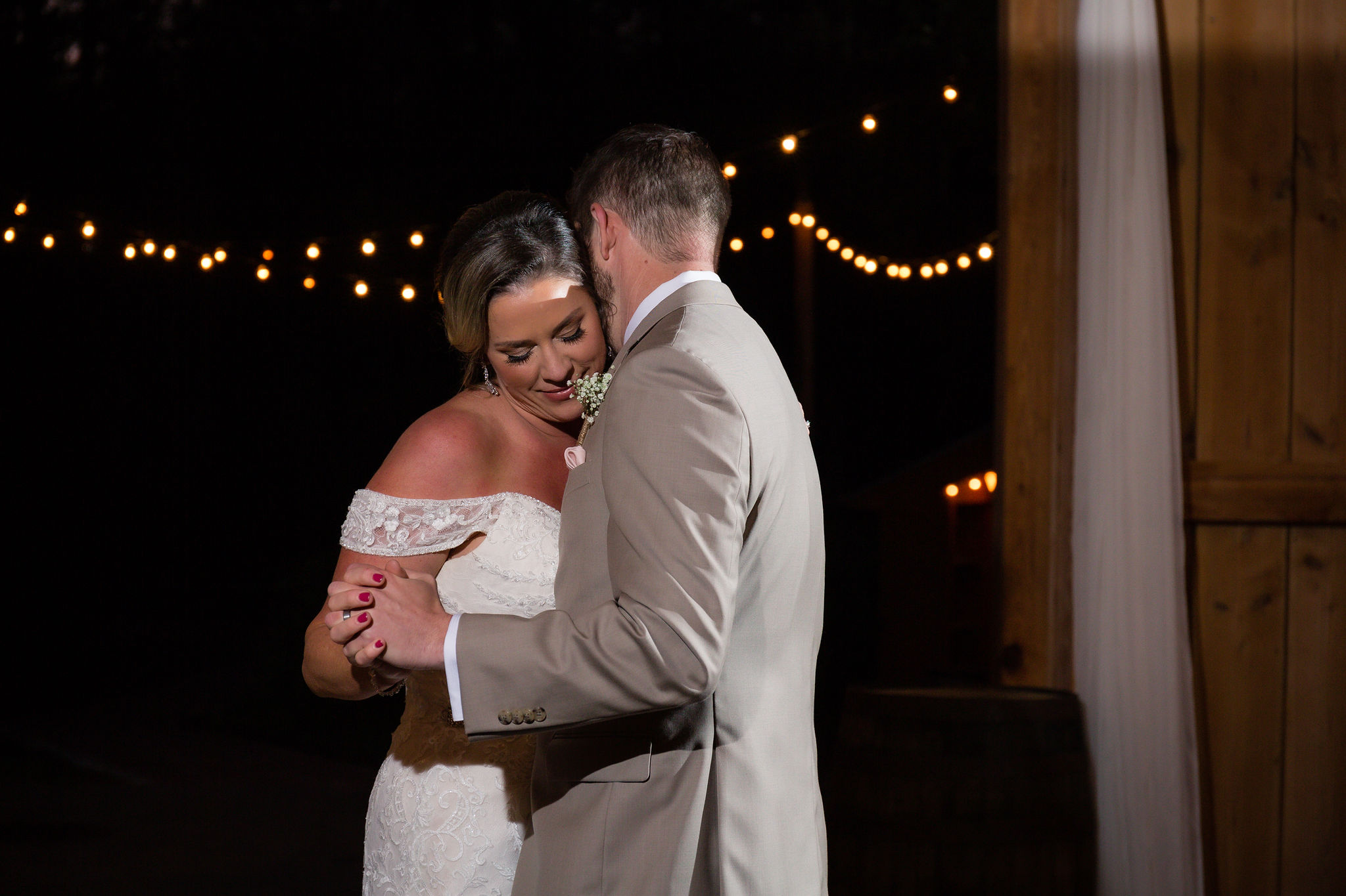 A sweet moment captured during their first dance.