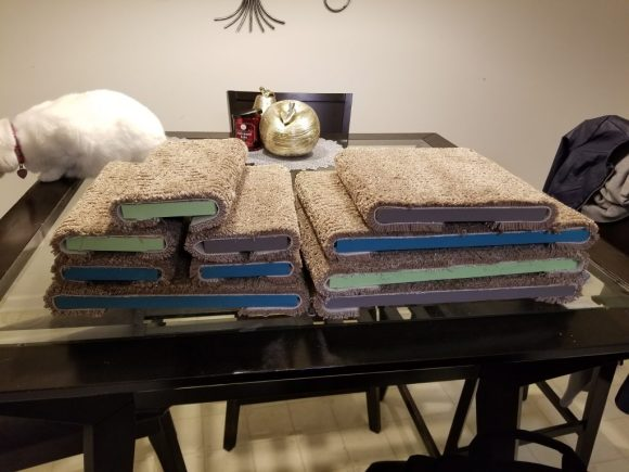 Table of carpeted DIY cat shelves