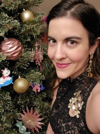 woman and cat boss babe next to tree with cat ornament