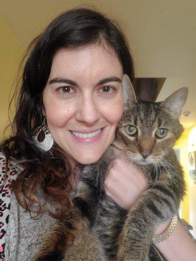 Woman holding tabby cat