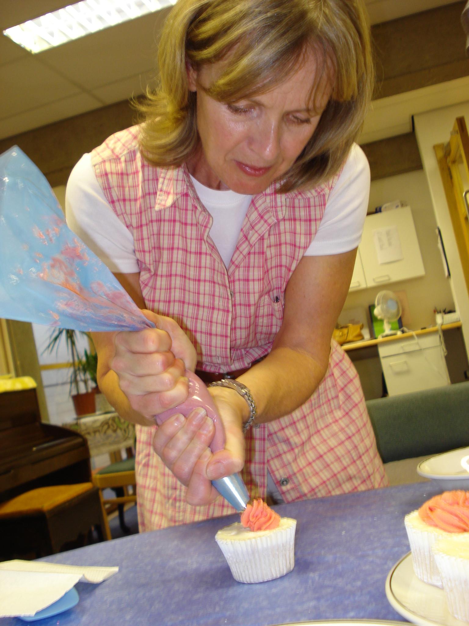 Carol decorating her cupcake