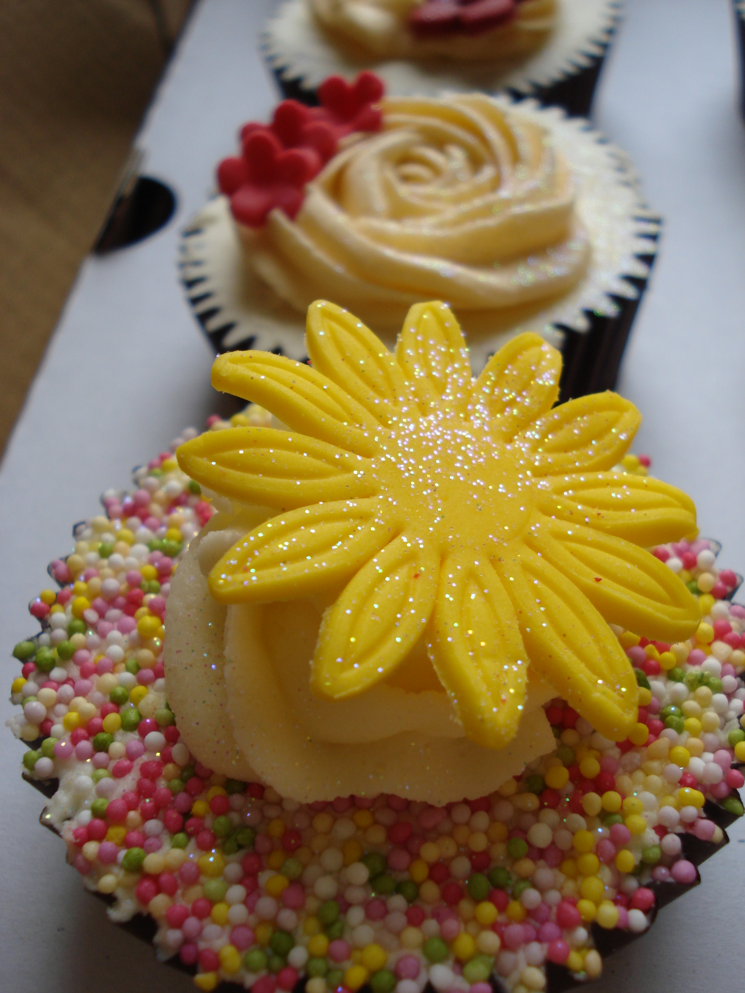 Yellow gerbera and sprinkles