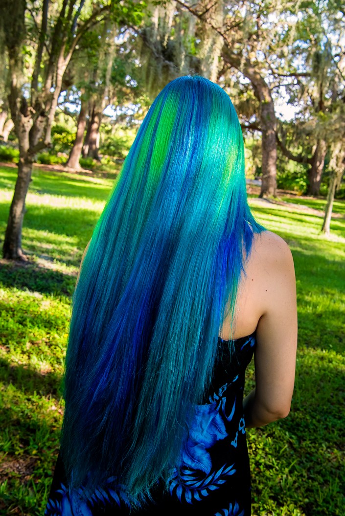 Very long blue and green hair dyed to look like an aurora using Manic Panic colors.