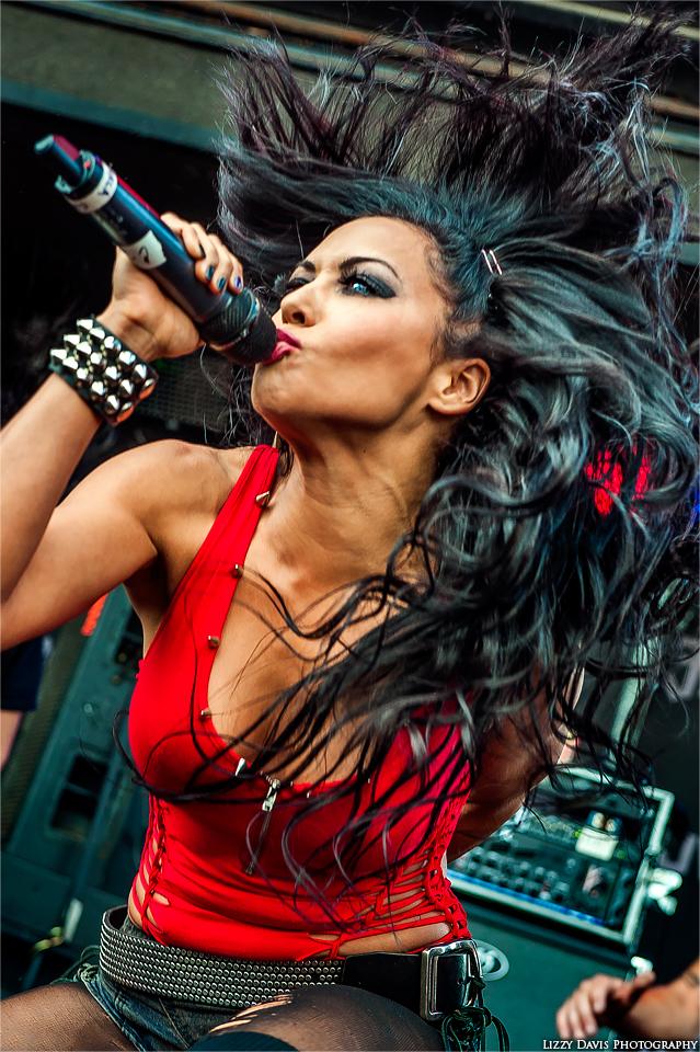 Vocalist Carla Coates of Butcher Babies flinging her hair at Rock on the Range.
