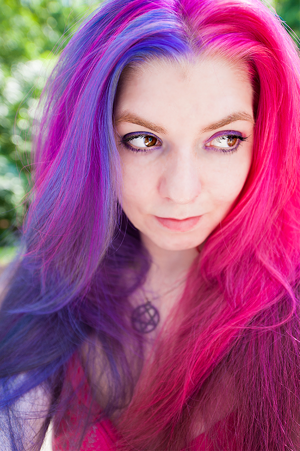 Half pink hair and half purple hair.