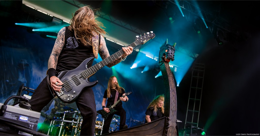 Amon Amarth bassist Ted Lundström head banging beside the Viking Ship.