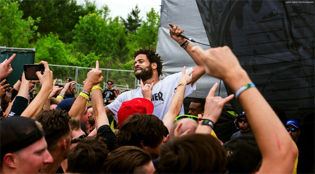 Volumes vocalist Myke Terry getting into the crowd at Carolina Rebellion. Photo by ©Lizzy Davis Photography
