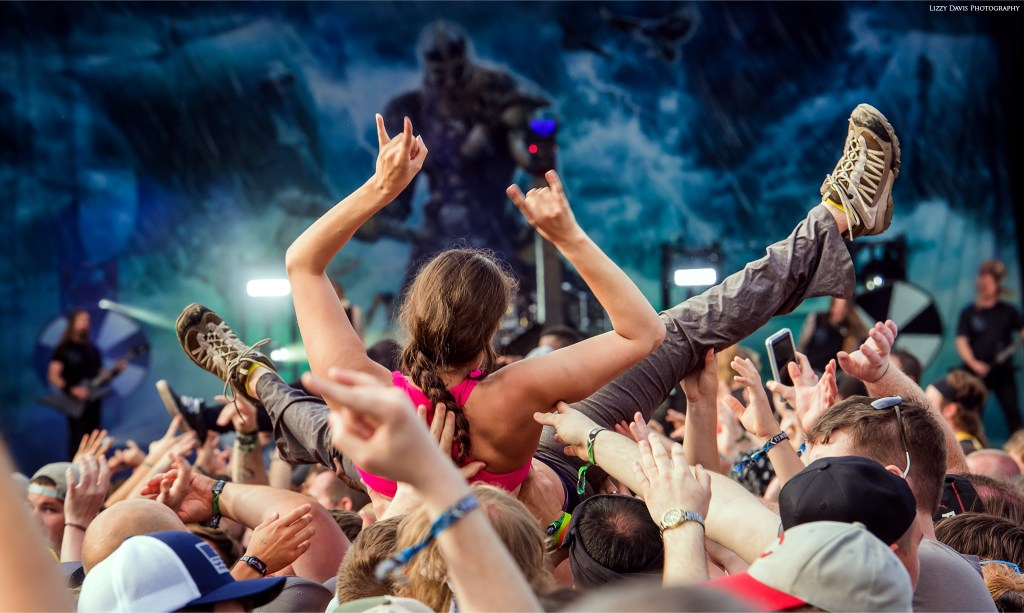 A crowd surfer floats toward Amon Amarth's stage.