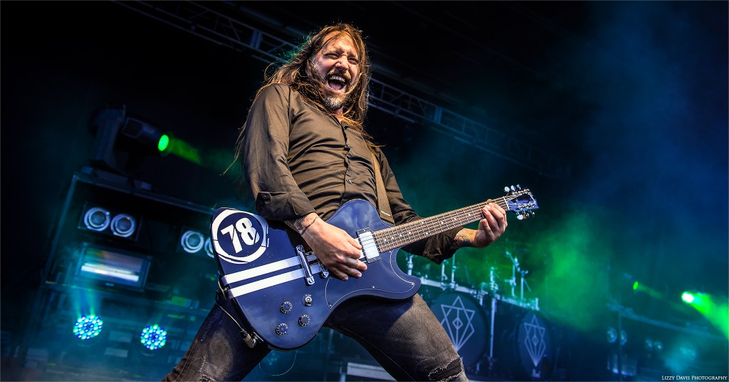 In Flames guitarist Niclas Engelin with a happy, energetic expression on his face. ©Lizzy Davis Photography