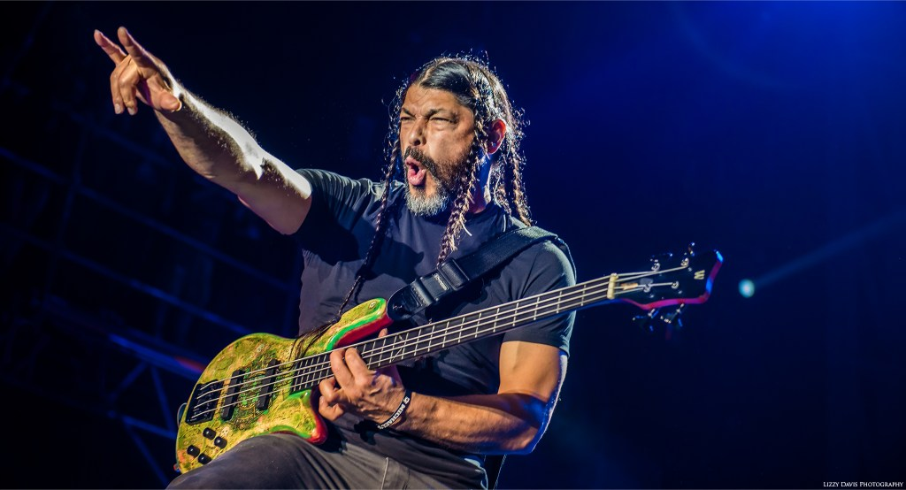 Metallica bassist Robert Trujillo throws rock horns to the crowd. ©Lizzy Davis Photography