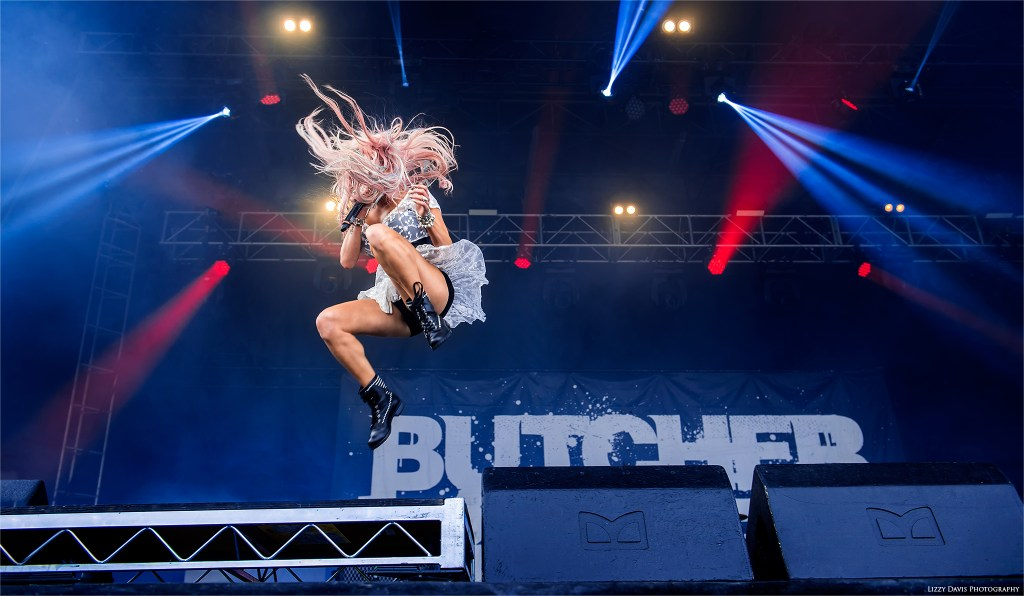Heidi Shepherd of Butcher Babies jumping off a riser at Chicago Open Air 2016. ©Lizzy Davis Photography