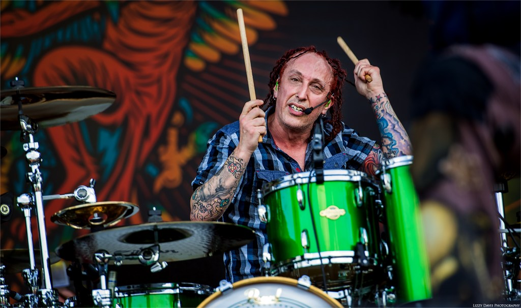 Drummer Morgan Rose of Sevendust giving me a look at Welcome to Rockville. ©Lizzy Davis Photography