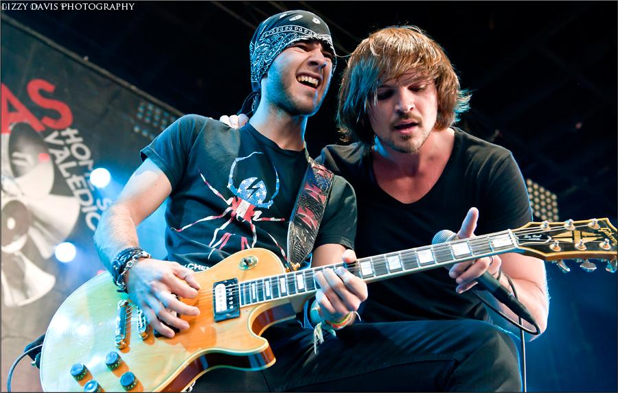 Adelitas Way vocalist Rick DeJesus helps guitarist Rob Zakaryan during their set at Rockstar Uproar 2012.
