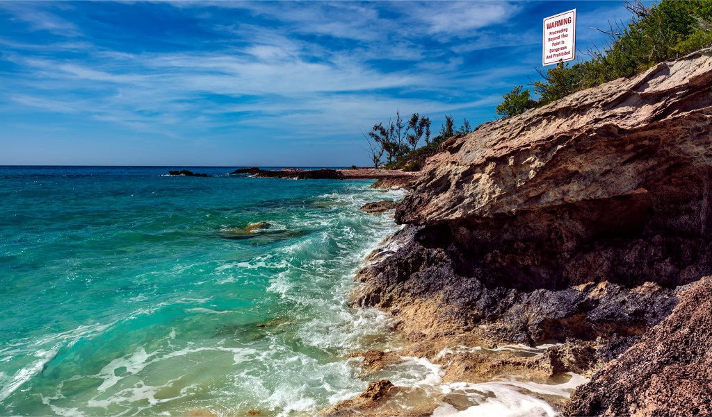 Photo of the warning sign at Half Moon Cay by Trevor Williams Photography.