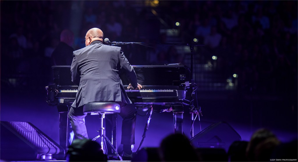 Billy Joel playing piano in Tampa. Concert photos by Lizzy Davis.
