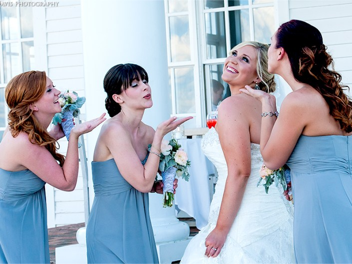 Bridesmaids blow a congratulatory kiss to the new Bride. Sanford, NC wedding photography by Lizzy Davis.