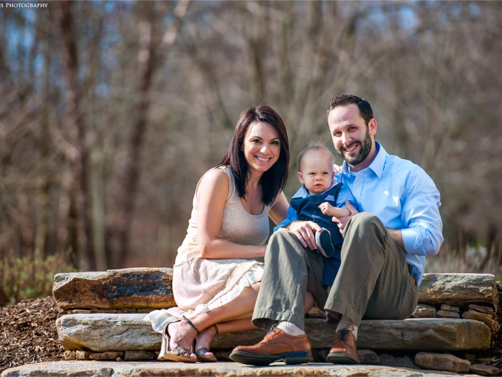 Outdoor portrait of a young family.