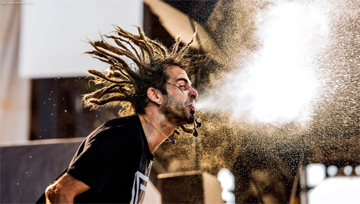 Randy Blythe of Lamb of God spitting out water at Welcome to Rockville festival 2016.