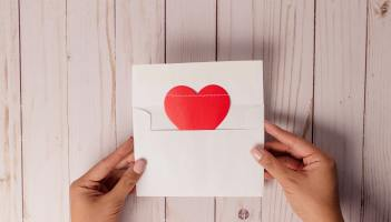 image of hands opening envelope with a red heart inside - email-marketing-copy-nottingham